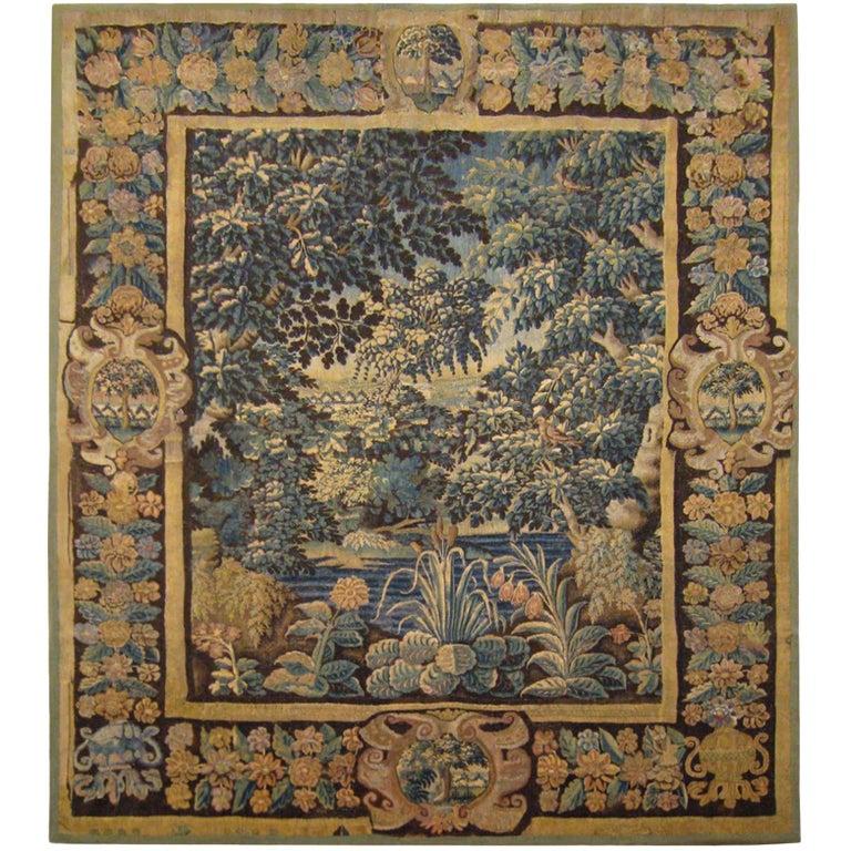 17th Century Flemish Verdure Landscape Tapestry, a Lush Forest & Pendant Border For Sale