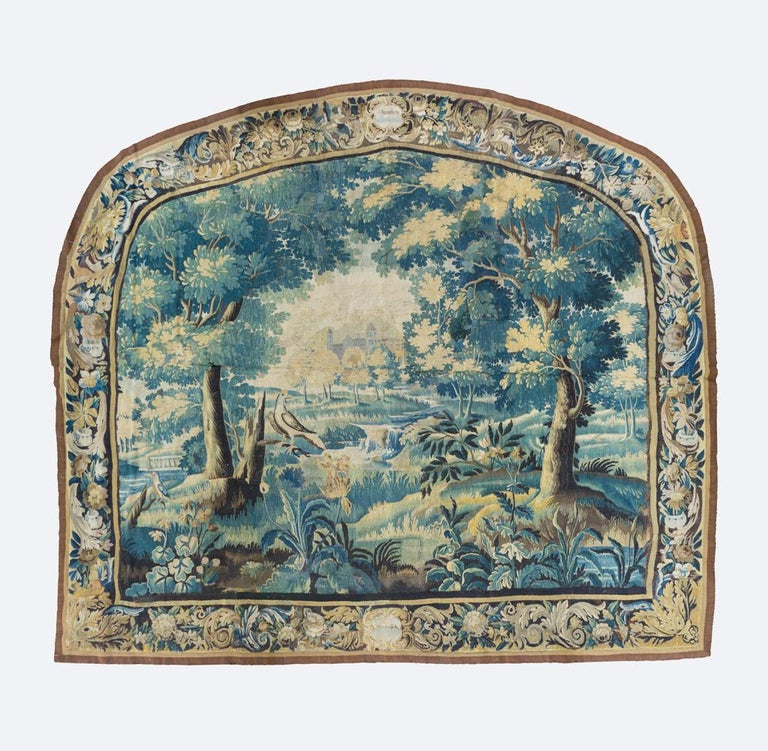 This is a gorgeous and rare pair of antique 17th century Flemish Verdure landscape tapestries depicting a beautiful and rich summer scene of a countryside with lush trees and vegetation, and birds with ornate gardens and a grand estate in the