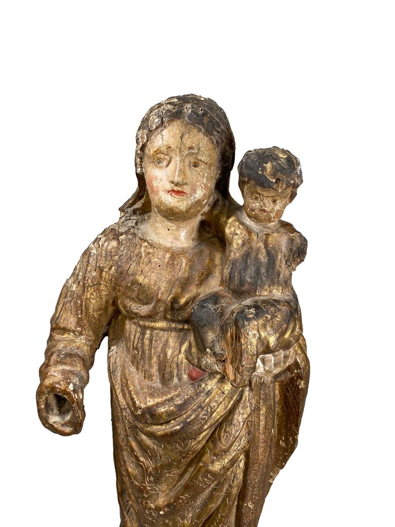 Statue of Mary and child is extremely unique in the sense that the back has been decorated, which was uncommon for the time period. From the south of France.