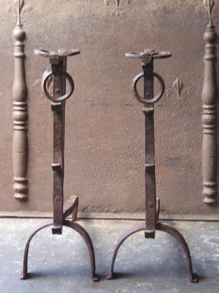 Magnificent pair of 17th century French Gothic andirons made of wrought iron. The tops of the andirons consist of bulls heads, which is characteristic for this type of andirons. The andirons are also called 'landiers' in France.