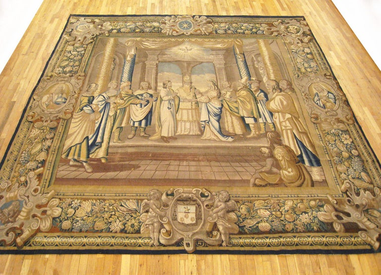 A French religious tapestry from Paris, circa 17th century, size 11' H x 11' W. This magnificent handwoven wool and silk wall hanging envisions the marriage of the New Testament figures, Mary and Joseph, with the High Priest flanked by Mary and