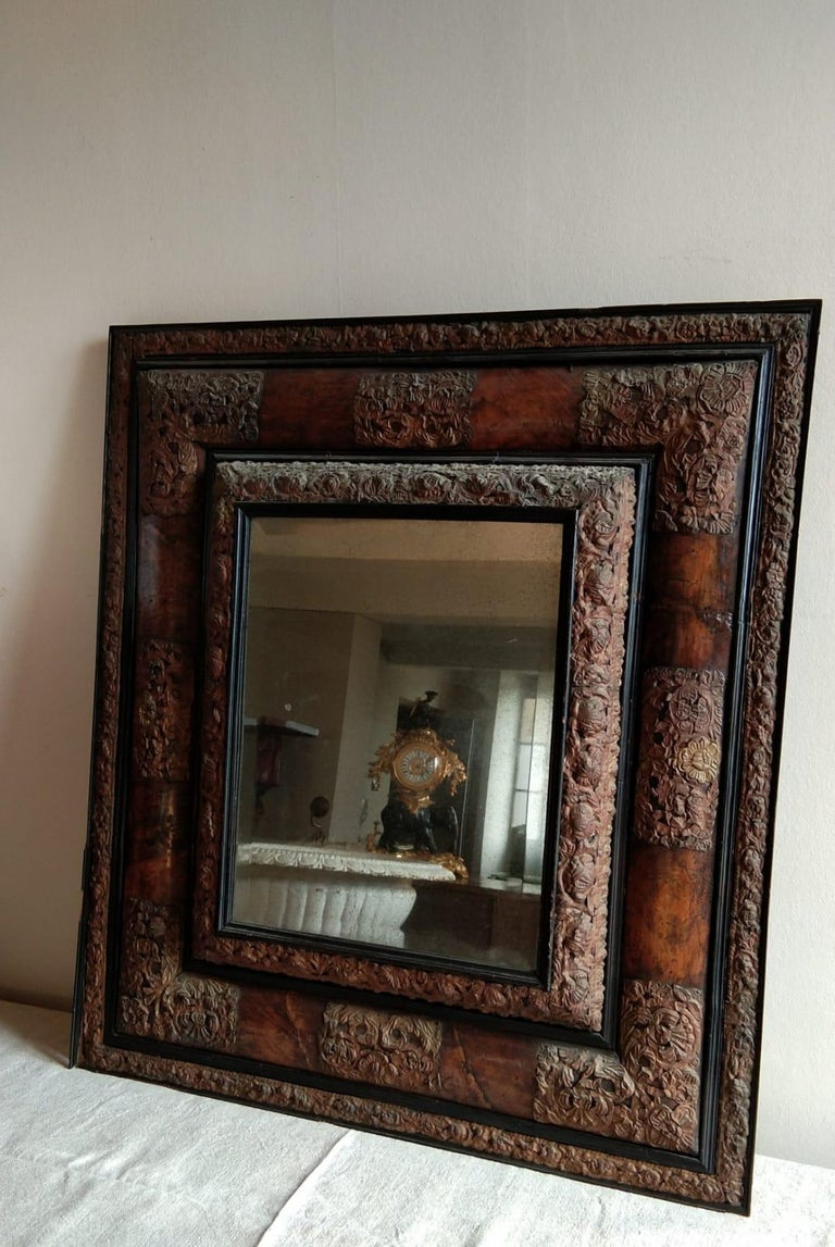 Louis XIII french mirror with original gilt from the 17th century. Large ebonised wood, copper and walnut frame.