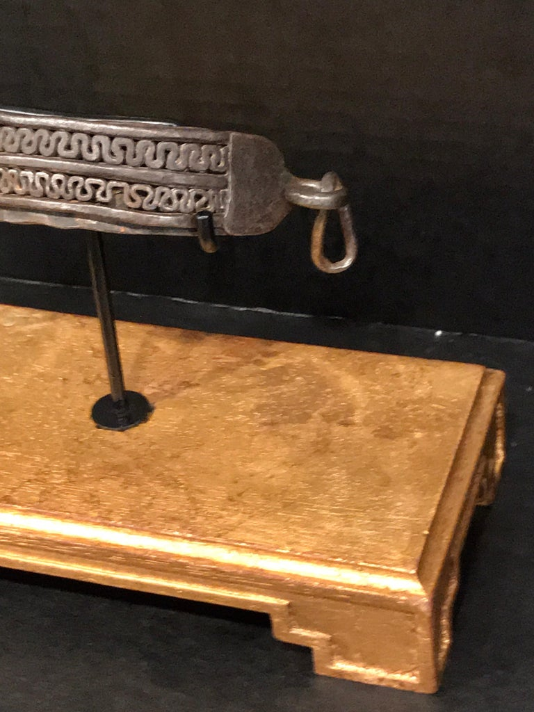 17th century iron dog collar, museum mounted on rectangular giltwood base. With two rows of neoclassic ironwork. The 6