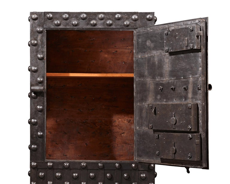 This rare Italian Baroque safe is crafted of reinforced wrought iron and is designed to be virtually indestructible. Intended to secure one's most precious valuables, the fascinating structure is enveloped in thick iron strapwork that surrounds its