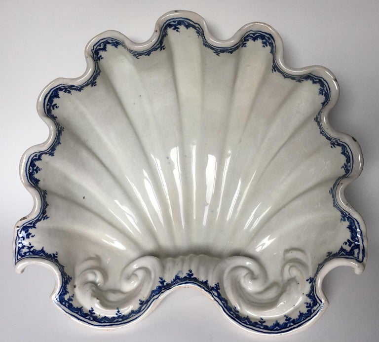 Centerpiece white maiolica shell Ferniani factory, early period: 1693-1776 Faenza, circa 1700  Measures: 5.6 in x 14.72 in x 13.46 in (14.3 cm x 37.4 cm x cm 34.2) lb 4.4 each (kg 2)  State of conservation: mimetic restoration on the front and