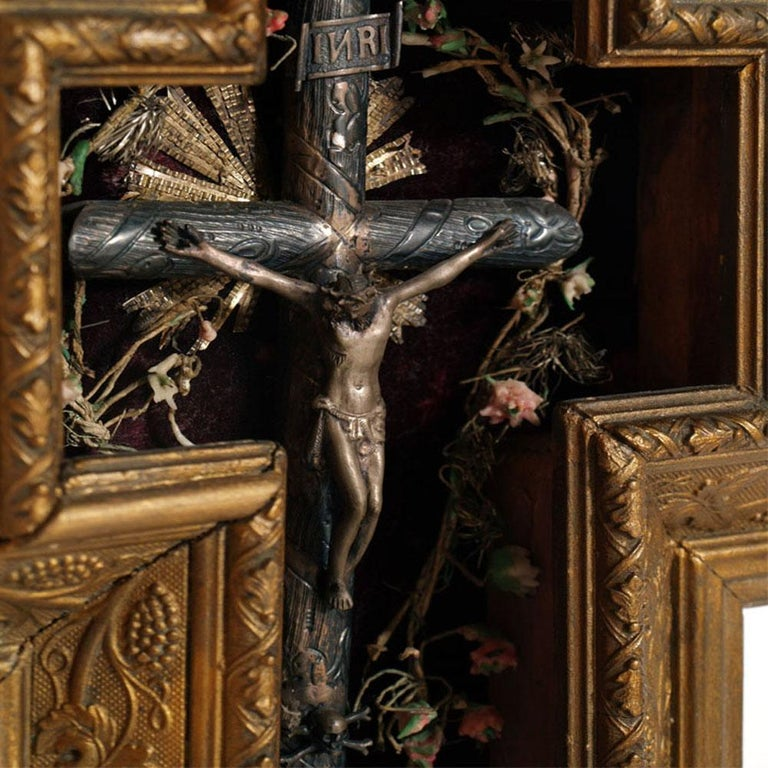 Very rare and precious 1600s Italian massive silver crucifix in bulletin board golden wood frame Measures cm: H 40, W 26, D 6  About: On an iconographic level, at least one detail must be observed: a skull with two crossed crossbones appears