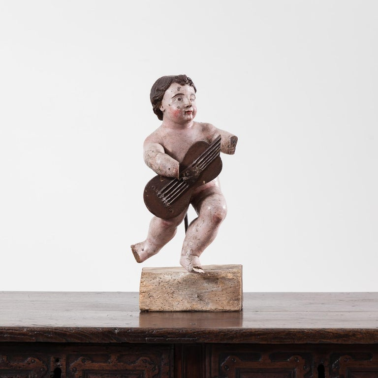 Fine late 17th century Italian carved putto. The piece has been re-painted, most likely in the 19th century.  The figure measures 42cm high on its own and 51cm high including the base.