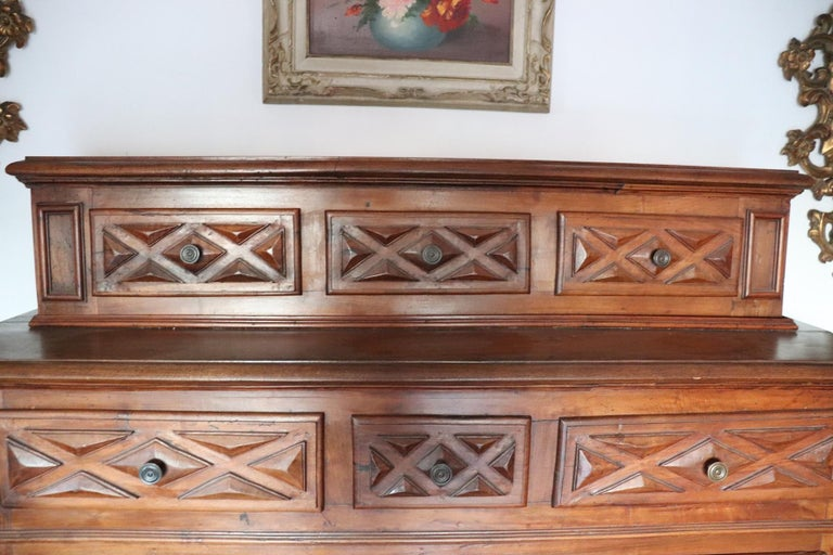 Beautiful rare large sideboard from the 17th century in Baroque Italian taste. The sideboard was in fact made by cabinet makers using wood and nails from the seventeenth century. Sideboard is also large in large internal useful space. Perfect for