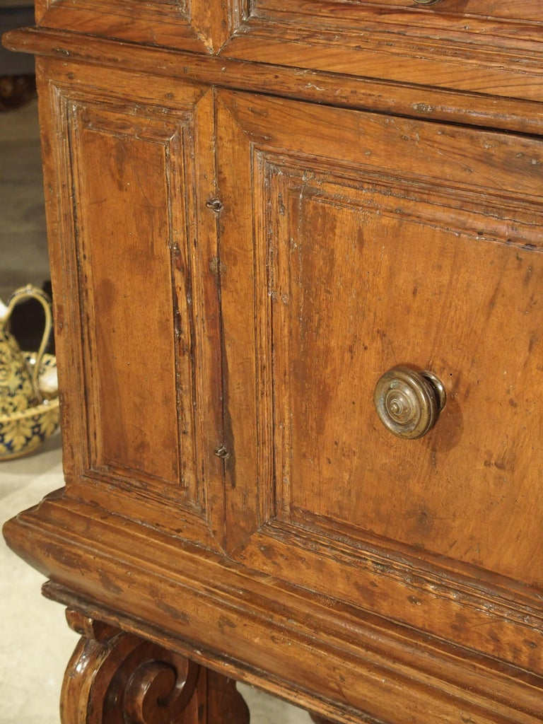 """This 17th century walnut wood cabinet comes from Italy and is known as a """"madia"""". A madia is a wide sideboard designed to hold an ample supply of loaves of bread, typically before baking. Although they have been in use for centuries, a madia"""