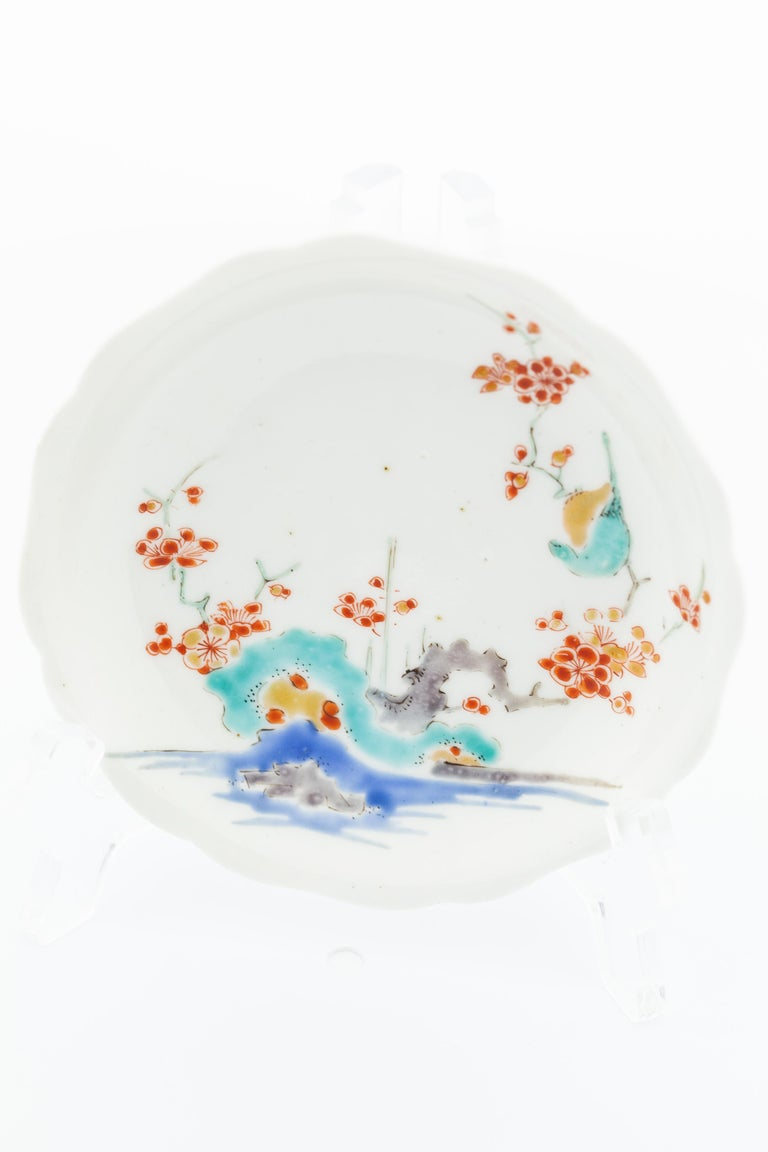 Title: Round Saucer with Plum Blossoms Date: 17th century Dimensions: (D) 10.9 (W) 10.7 (H) 2 cm Condition: Wear consistent with age and use. Base rim chipped slightly. Minor adhesive residue on base.  A small round saucer decorated with