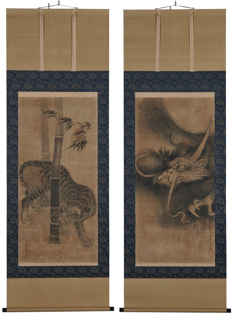 Tiger and Dragon  Soga Nichokuan (active, circa 1625-1660)  Pair of hanging scrolls, ink on paper.  Dimensions:  Each scroll 118 cm x 57 cm.  Each image 215 cm x 73 cm.  This is a large and rare pair of dragon and tiger paintings by the