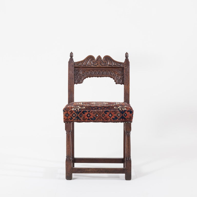 Delightful 17th century joined oak back stool.  The seat is upholstered in an old carpet fabric.  Height 96cm x Width 53cm x Depth 44cm. Seat Height 53cm.