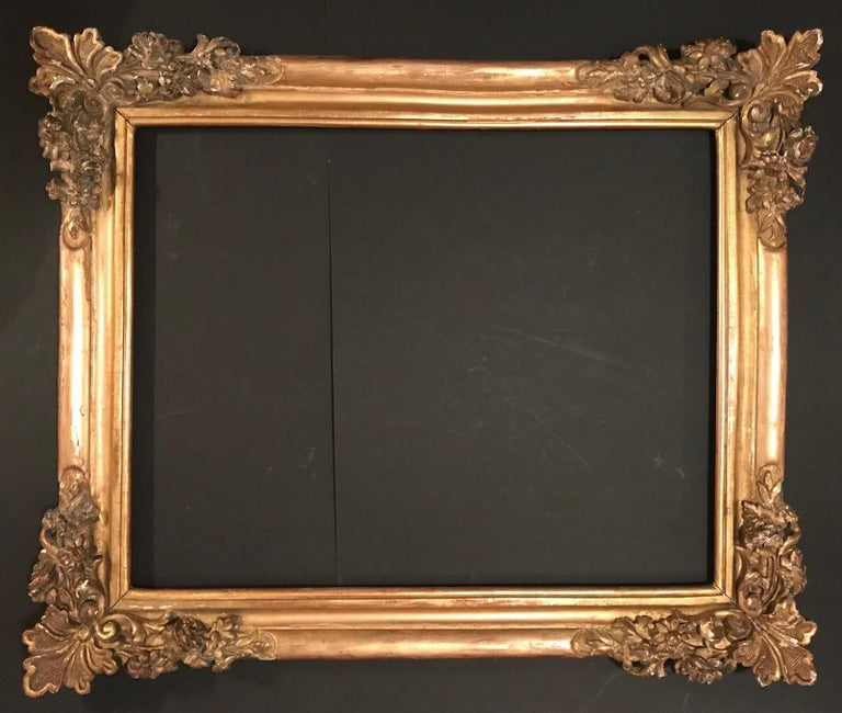This significant and rare frame dates from the period of Louis XIV, the French Sun King. The rich decoration is hand carved in great detail and gilded over gesso. The fantastic design is a typical example of 17th century French Baroque frames.