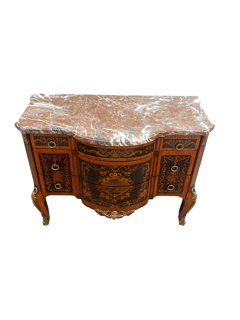 A handsome period Louis XVI commode from the later half of the 18th century. Heavy use of marquetry and parquetry inlays using tulipwood, kingwood and rosewood throughout the sides and drawer fronts the case was constructed with oak. The legs