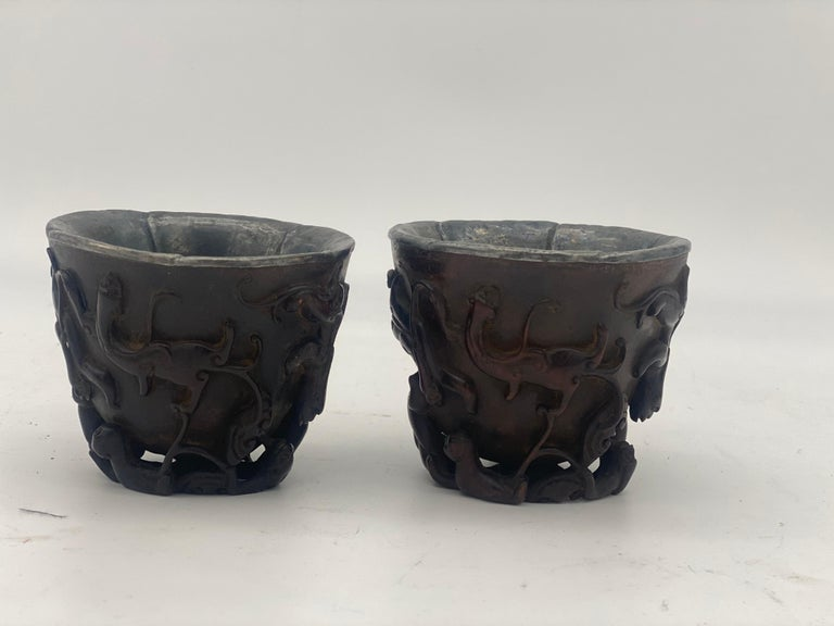 17th century a pair of Ming dynasty Chinese ZiTan inlaid silver cups, the exterior carved in high relief and undercut around the sides and base with Chi dragon, 5 edges with silver lining, dimensions: 8.5cm x 7.2cm high.