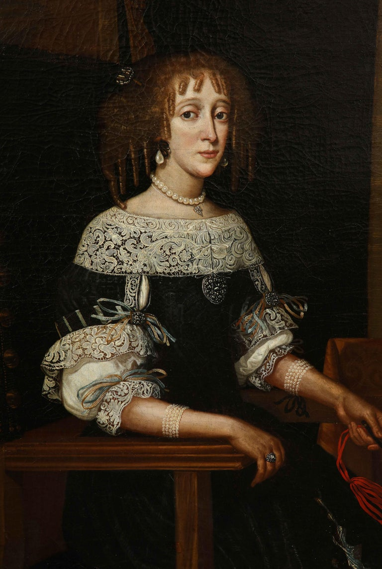 Fine Charles II period oil on canvas portrait of a noblewoman, her black dress with exquisitely painted white lace, wearing pear drop pearl earings and a pearl necklace, seated in leather upholstered armchair and holding a fan with red ribbon