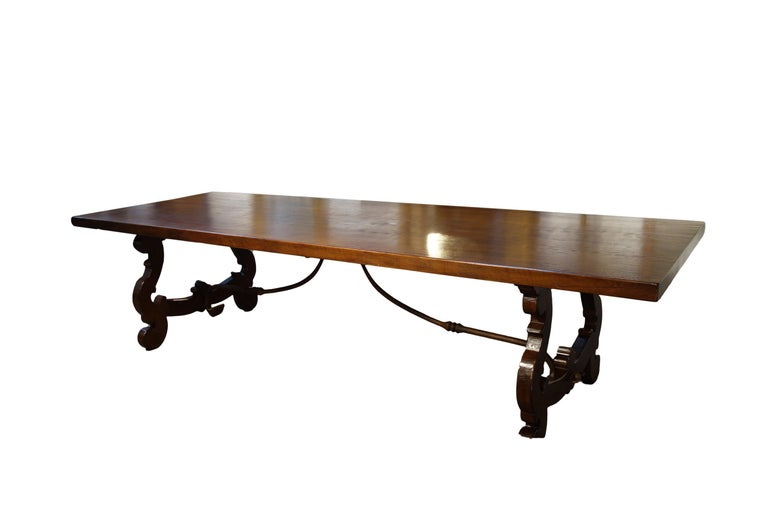 17th century refectory style dining table opens to 14' with end extensions, available as shown or in custom lengths. Our Classic Lira Old Walnut solid refectory table with lyre-shaped bases, handcrafted in reclaimed, aged premium Italian walnut,