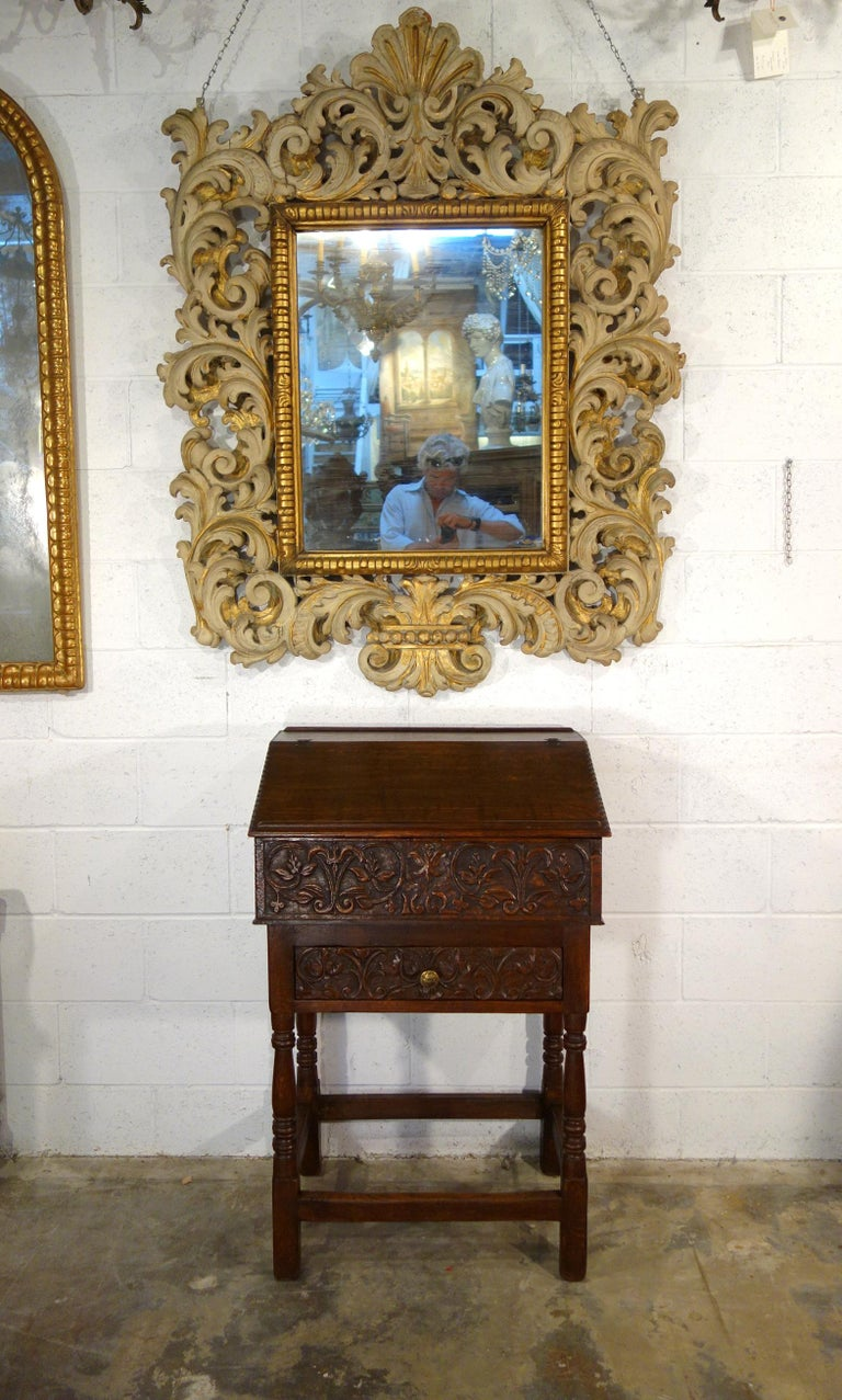 Unique 17th Century Renaissance style leggio bookrest suitable as a reading, music desk or presentation lectern, as it is paired with and permanently mounted to the 19th century chestnut table base with similarly carved drawer, turned legs and