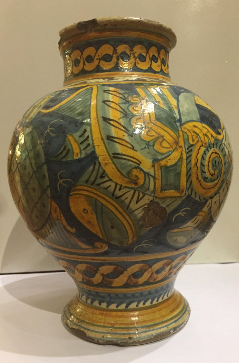 17th century Sicilian Maiolica with central medallion with figure of Saint of typical bowl shape decoration with foliage of the manufacture of the town of Sciacca with inscribed inscription SPQR.