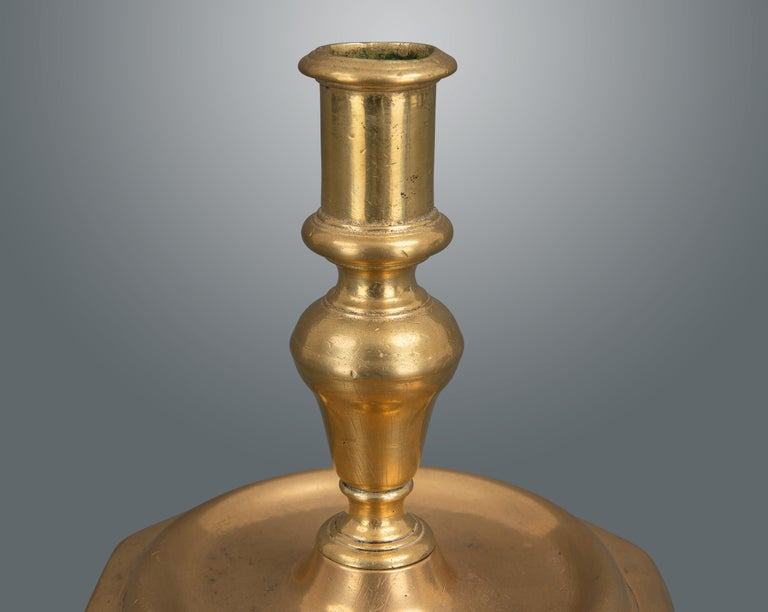 A very nice example in rose colored brass. Heavily cast in two pieces with a screw fitting and six sided base.
