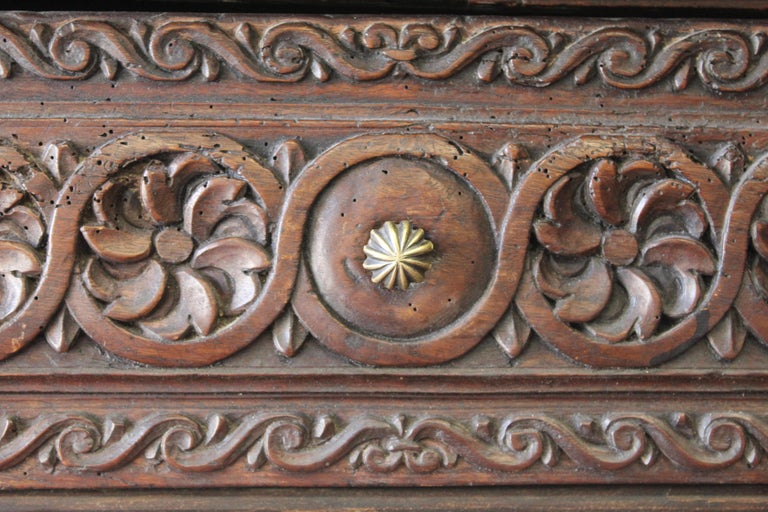 Intricately carved two-drawer walnut library table, 17th century, Spanish.
