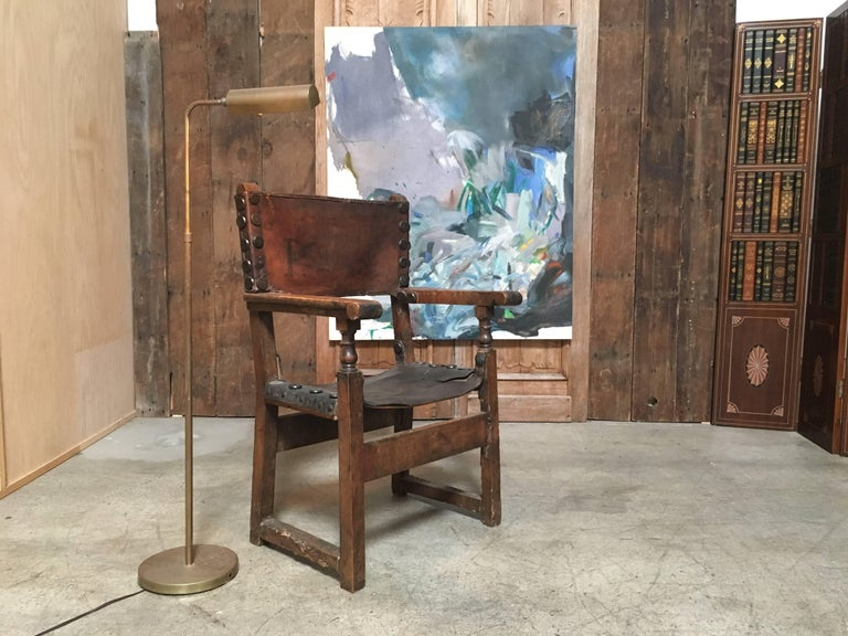 This chair has wonderful distressed patina of the leather and the wood perfect for a Tuscan, French or Spanish style home.