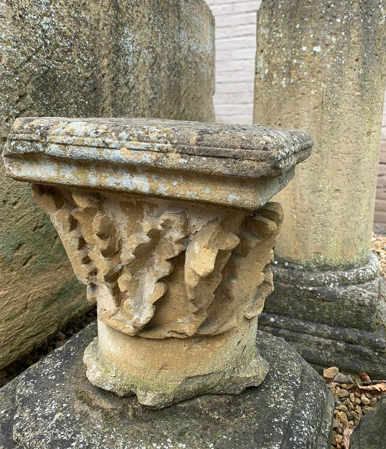 A large 17th century French capital on a associated base. Sculpted front and sides, flat backside. Great to decorate a garden or display indoors.