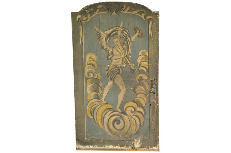 An exquisite and rare 17th century double sided Palazzo door from Venice, Italy. This sensational door is constructed with a wooden frame, canvas sides and its iron hardware. Two different beautiful oil paintings adorn the sides of the door. A