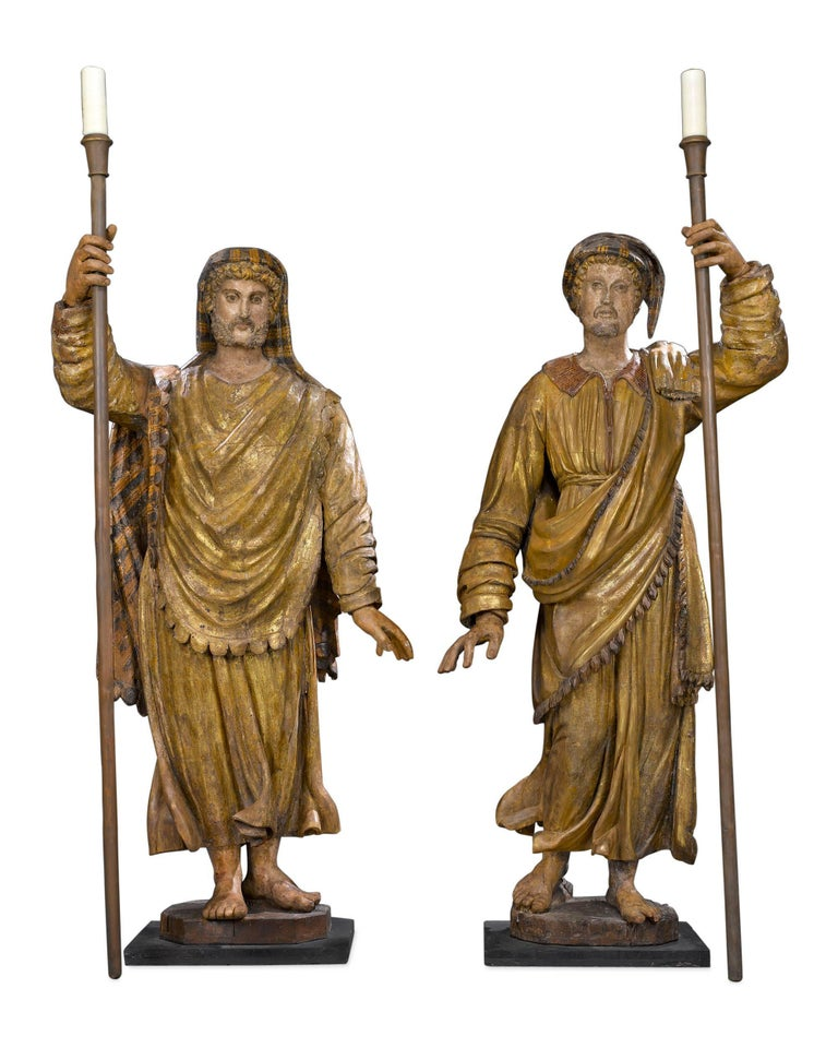 Awe-inspiring in size and artistry, these incredible Venetian figural torchères pay homage to two of Italy's most celebrated merchant explorers–Marco Polo and Amerigo Vespucci.  Standing over nine feet high, these impressive carved wood sculptures