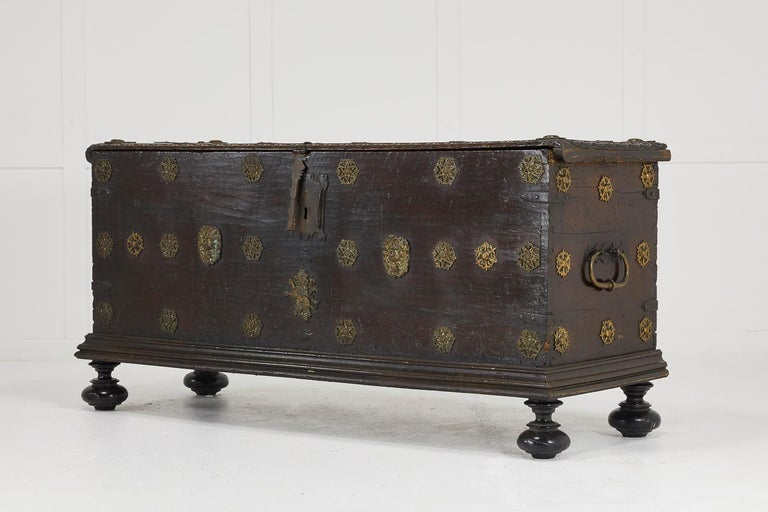 17th Century walnut Spanish trunk with great patina and fantastic applied brass-work.  Dimensions: H 27¾
