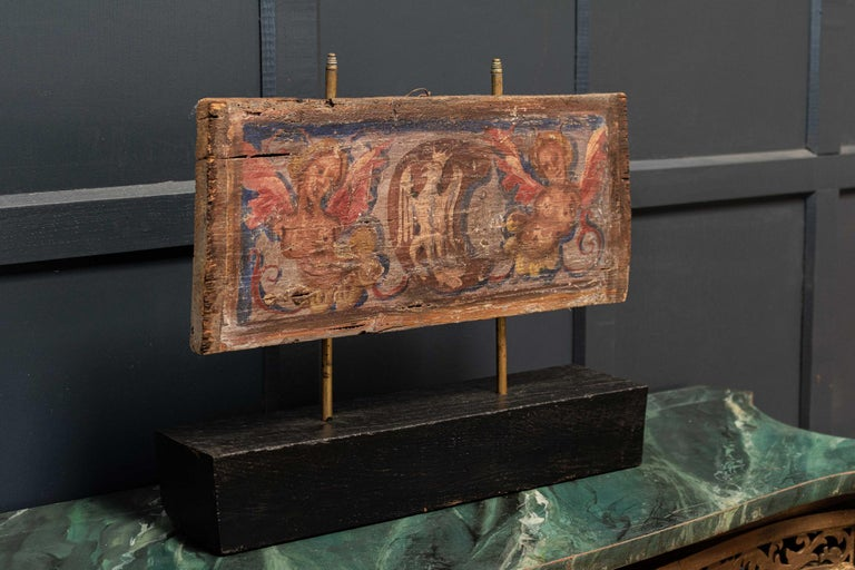 Circa 1680.  17thc polychrome painted ceiling panel  Mounted on a later block     Measures: W48 x D11 x H39.5cm.