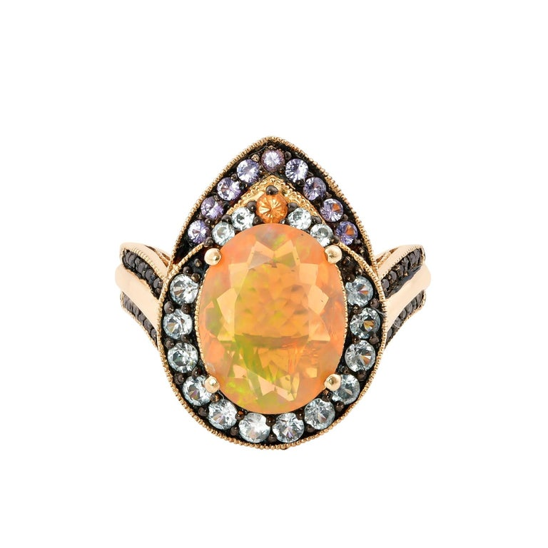 Oval Cut 1.8 Carat Ethiopian Opal Ring in 14 Karat Yellow Gold with Diamonds For Sale