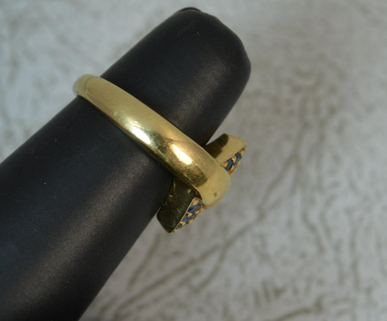 18 Carat Gold and Blue Sapphire Buckle Band Ring For Sale 5