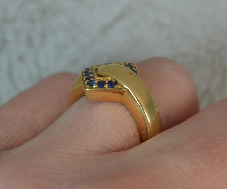 Art Deco 18 Carat Gold and Blue Sapphire Buckle Band Ring For Sale