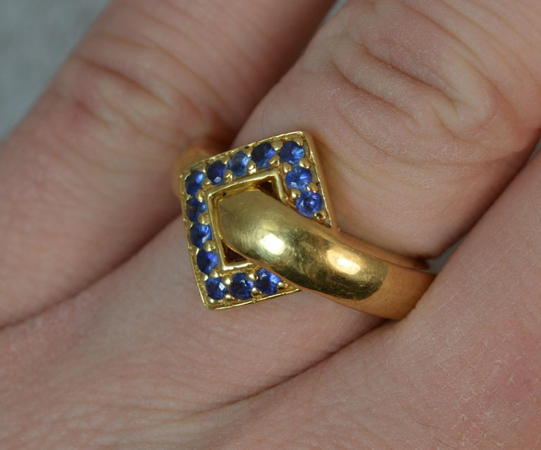 18 Carat Gold and Blue Sapphire Buckle Band Ring In Excellent Condition For Sale In St Helens, GB
