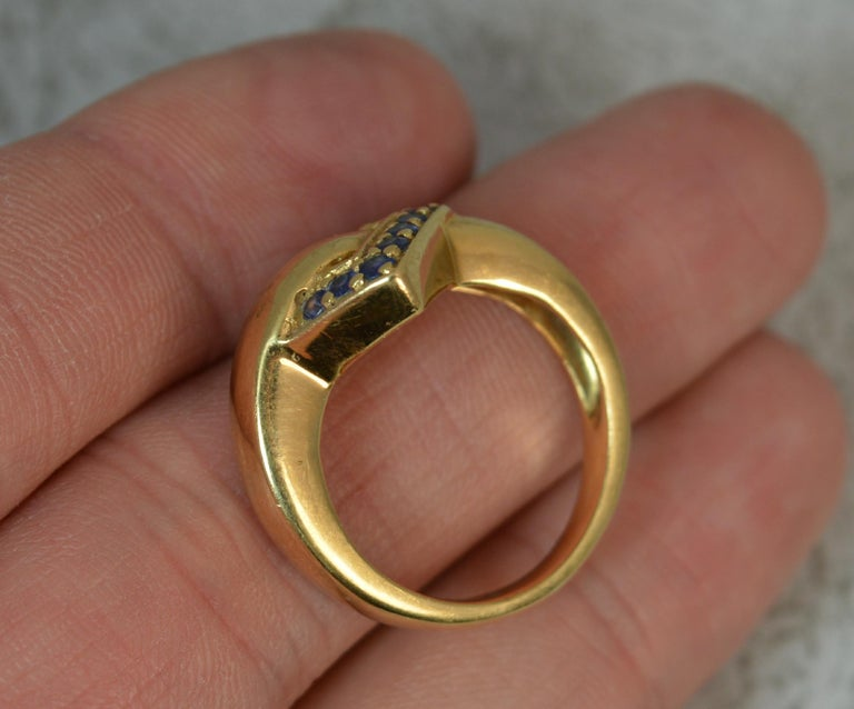 Women's 18 Carat Gold and Blue Sapphire Buckle Band Ring For Sale