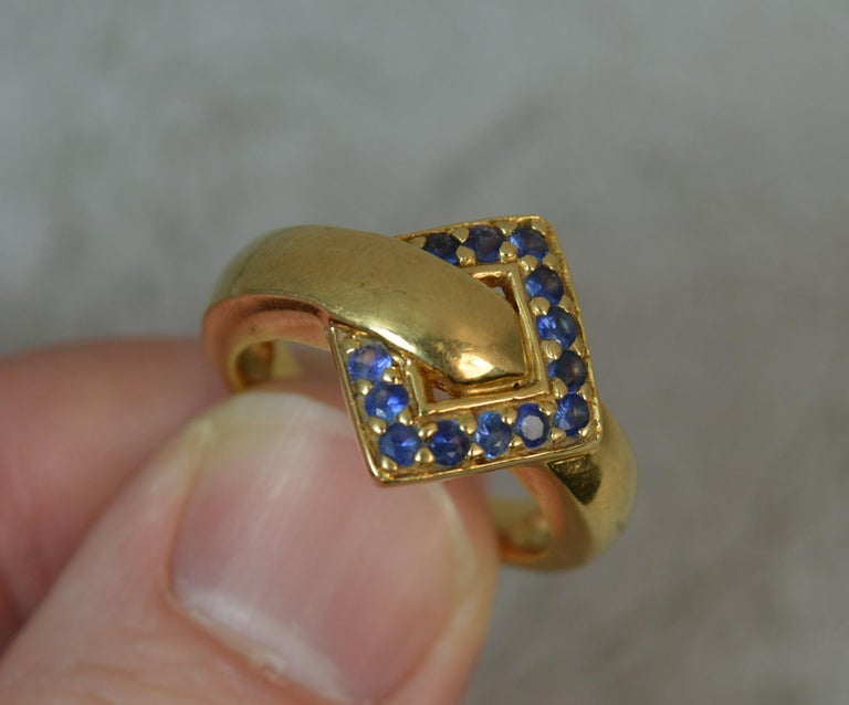 18 Carat Gold and Blue Sapphire Buckle Band Ring For Sale 1