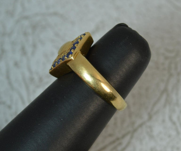 18 Carat Gold and Blue Sapphire Buckle Band Ring For Sale 3