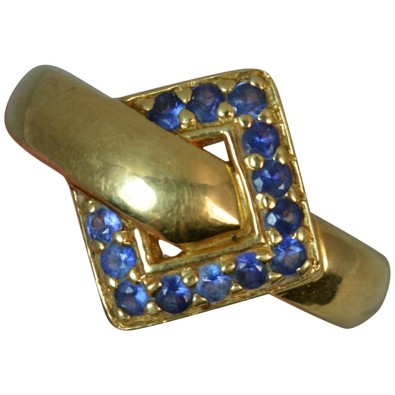 18 Carat Gold and Blue Sapphire Buckle Band Ring For Sale