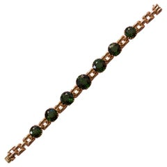 18 Carat Gold and Green Tourmaline Bracelet