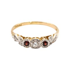 18 Carat Gold and Platinum Round Diamond and Red Garnet Three Stone Vintage Ring