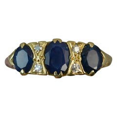 18 Carat Gold Blue Sapphire and Diamond Cluster Ring
