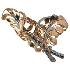 18 Carat Gold Diamond and Sapphire Retro Feather Brooch