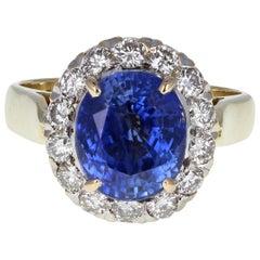 18 Carat Gold Oval 6.50 Carat Ceylon Blue Sapphire Diamond Cluster Cocktail Ring