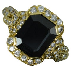18 Carat Gold Rectangular Sapphire and 56 Diamond Cluster Ring