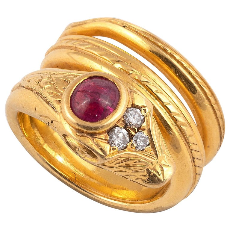 18 Carat Gold Ruby and Diamond Snake Ring For Sale
