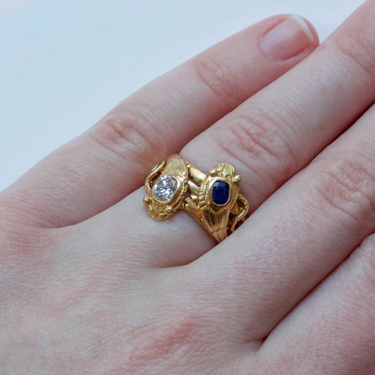 18 Carat Gold Sapphire and Diamond Double Snake Ring For Sale 1