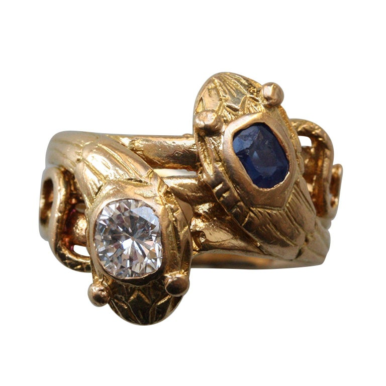 18 Carat Gold Sapphire and Diamond Double Snake Ring For Sale