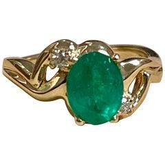 1.8 Carat Natural Oval Emerald and Diamond Ring 14 Karat Yellow Gold