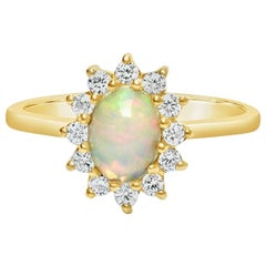 18 Carat Opal Engagement Ring with High Quality Diamonds